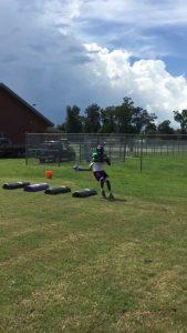 Quarterback Brian Byrd goes through footwork drills Thursday.